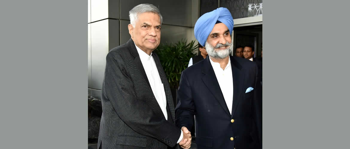 Hon'ble Prime Minister of Sri Lanka Mr.Ranil Wickremrsinghe  is greeted  by Shri Taranjit Singh Sandhu, High Commission of India in Sri Lanka