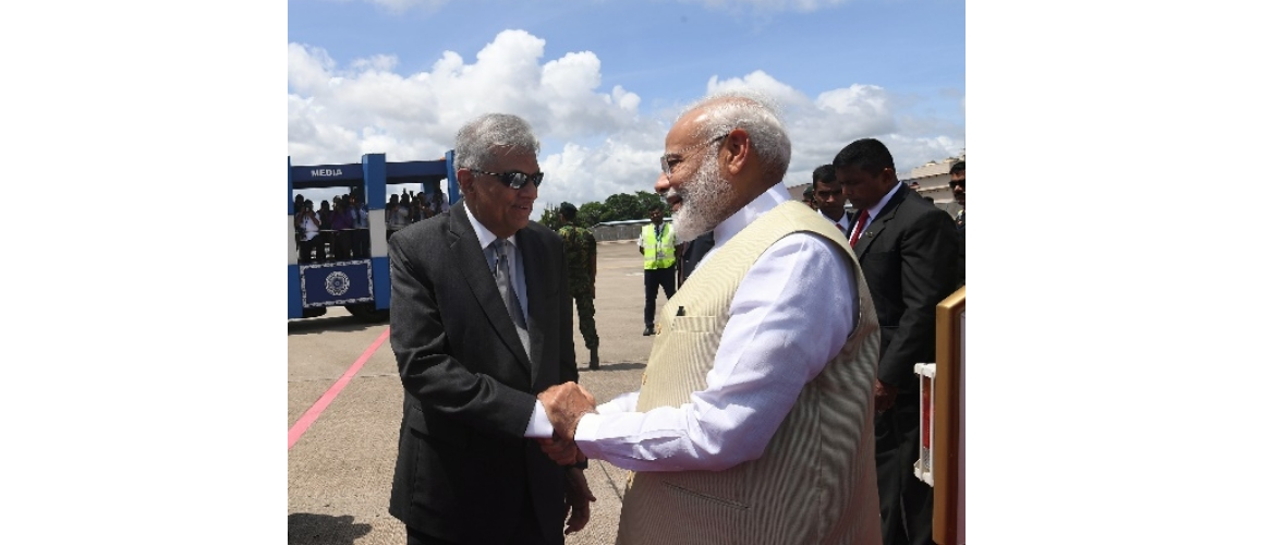 Hon'ble Prime Minister of India, Shri Narendra Modi, received by Hon'ble Prime Minister of Sri Lanka, Mr. Ranil Wickremesinghe, at the Bandaranaike International Airport on June 9, 2019